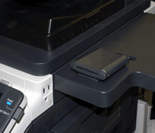 The proximity and HID iCLASS card authentication device (AU-201H/AU-202H) and CAC/PIV (AU-211P) connect directly to the USB port of Konica Minolta workgroup multifunction printers