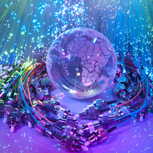 Fibre optic cabling surrounding the globe, symbolic of how fibre optic cabling is becoming a global choice of transmission over coax