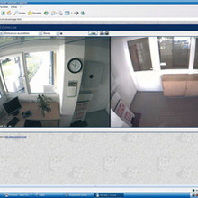 The monitor image shows the layout of both buildings and small surveillance images are displayed on the screen at each of the camera locations