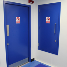 ASSA ABLOY cleanroom doors provide superior quality to meet stringent requirements of cleanrooms, in accordance with ISO14644 cGMP and are fire certified for up to 60 minutes