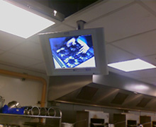 Individual monitors above each students work area